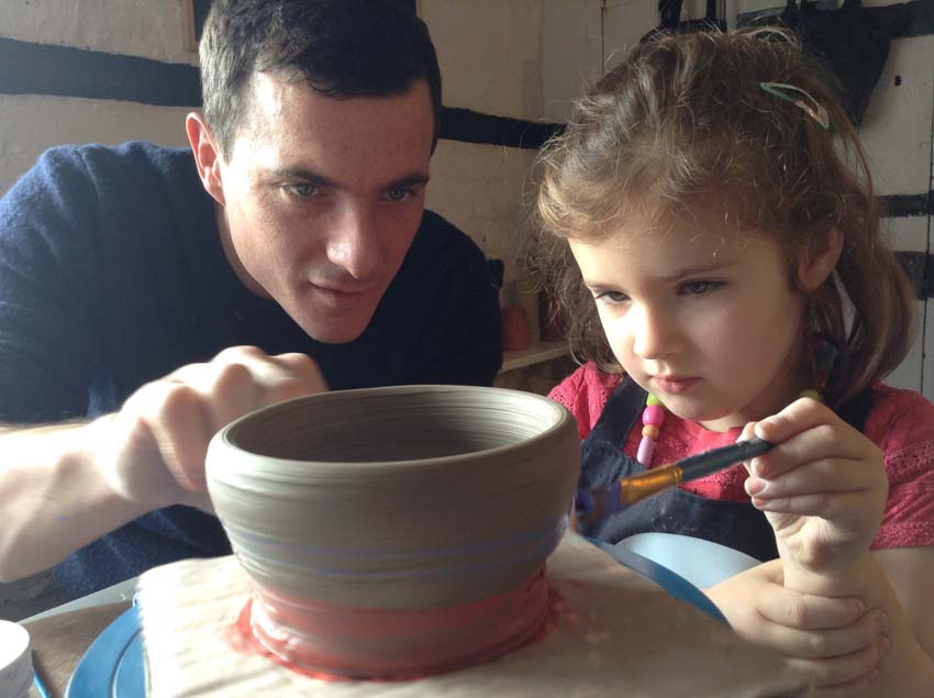 daughter and dad make pottery together at Eastnor Pottery